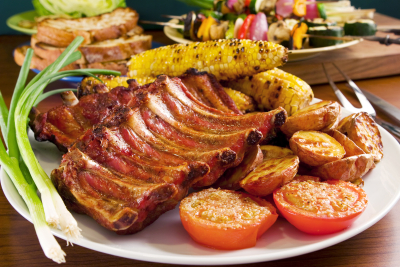 grilled pork ribs, corn and potatoes